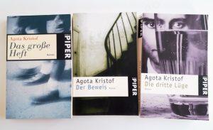 """Buchcover von Agota Kristofs Büchern """"Das große Heft"""", """"Der Beweis"""" und """"Die dritte Lüge"""""""